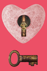 Pink stone heart with keyhole and old key