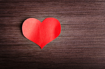 Valentine's Day background. red heart on a wooden background