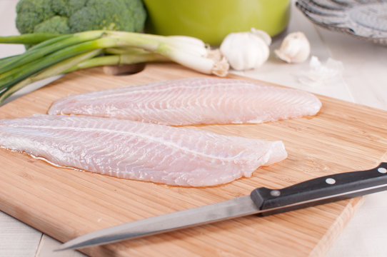 Defrosted fish fillets with vegetables