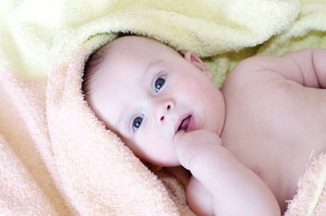 The baby in an orange towel (4 months)