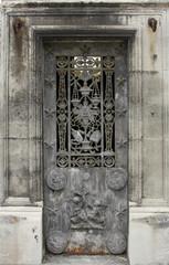 Ornate tomb door in the Pere Lachaise cemetery, Paris