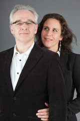 Happy middle aged couple. Man and woman. Studio shot.