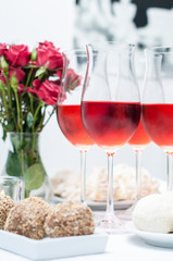 Rose wine in glasses, home party