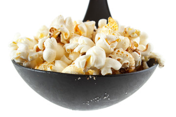 Homemade popcorn on scoop , isolated on white