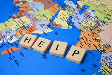 Fotobehang Wereldkaart help the world