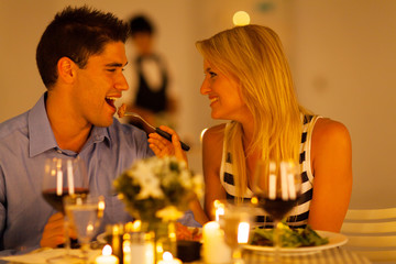 loving couple having romantic dinner in a restaurant
