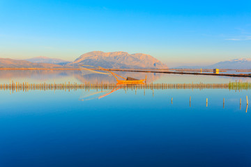 Central Greece,  wooden fishing boat view inside lake  in Tourli