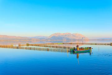 Central Greece, fisherman fishing inside lake in Tourlida Greece