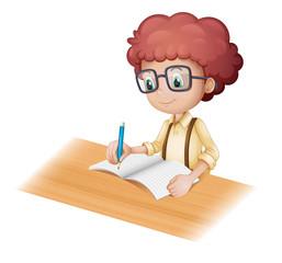 A nerd boy writing