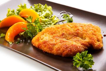 Pork chop, peaches and vegetable salad
