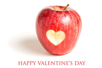 Red apple with heart on white background