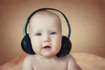 little kid with headphones