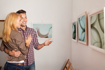 young atractive couple at an art exhibition