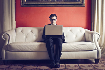 businessman working on sofa