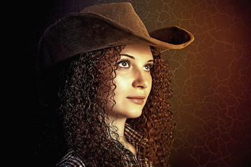 portrait of pretty curly girl cowboy