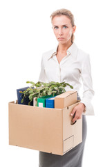 Portrait of business woman holding a box with her belongings
