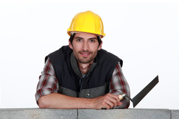 Bricklayer with trowe