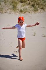 Fototapete - Mädchen am Strand