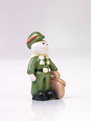 A ceramic doll of military cadet student in uniform  isolated on