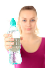 Woman in sportswear drinking water, isolated on white