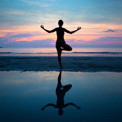 Yoga, harmony of health (silhouette young woman on the beach)