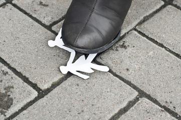 Paper man for shoes on the asphalt