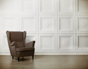 Fototapeta One classic armchair against a white wall and floor obraz