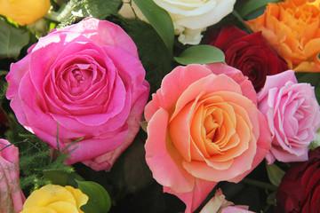 Multicolored roses in flower arrangement