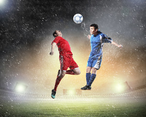 Spoed Fotobehang Voetbal two football players striking the ball