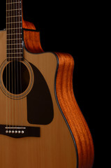 acoustic  guitar on a black background