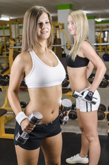 Sexy Girls in Fitness Studio