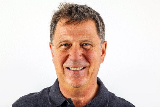 handsome smiling man in black leisure shirt