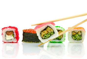Japanese sushi and chopsticks on white background