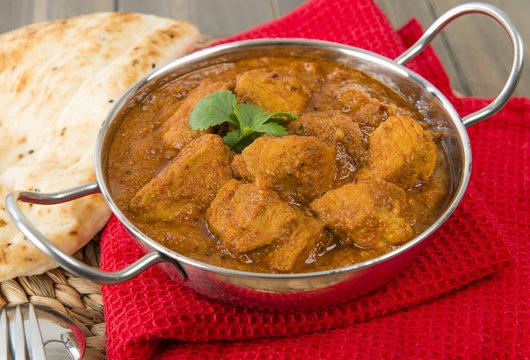 Goan Pork Vindaloo - Indian pork curry with naan bread