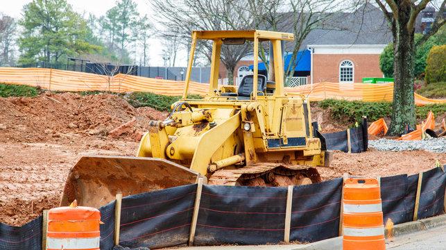 Yellow Bulldozer on Dirt Site