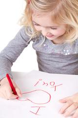 little girl writting I love you