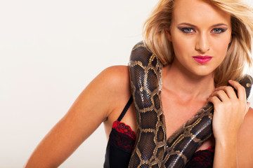 young fashion woman posing with snake