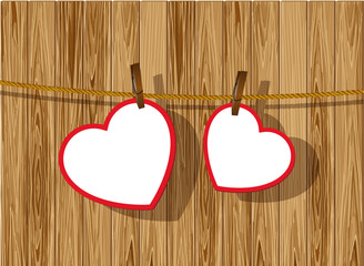 Heart frames on wood background.