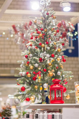 New year trees with decorations and accessories in large mall