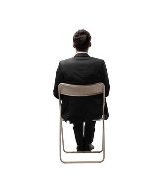 businessman sitting back