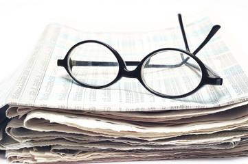 old glasses on newspaper