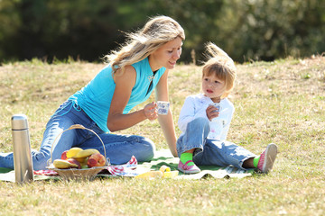 Mom and daughter on picnic