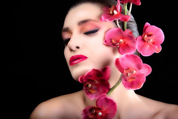 Beautiful Girl With Orchid Flowers. Face. Makeup.