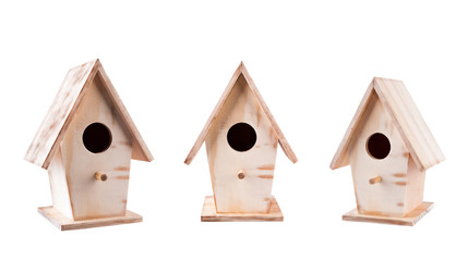 Set of 3 wooden birdhouses rough at different angles