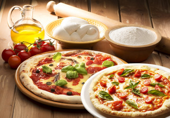 pizza with ingredients on wooden table