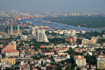 Bangkok city and Chaophraya River from bird's-eye view in evenin
