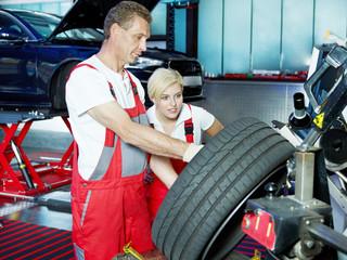 Mechanic is teaching his apprentice
