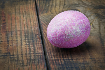 decorated with purple glitter easter egg