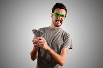 guy holding poker cards