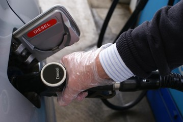 Refueling a car with diesel